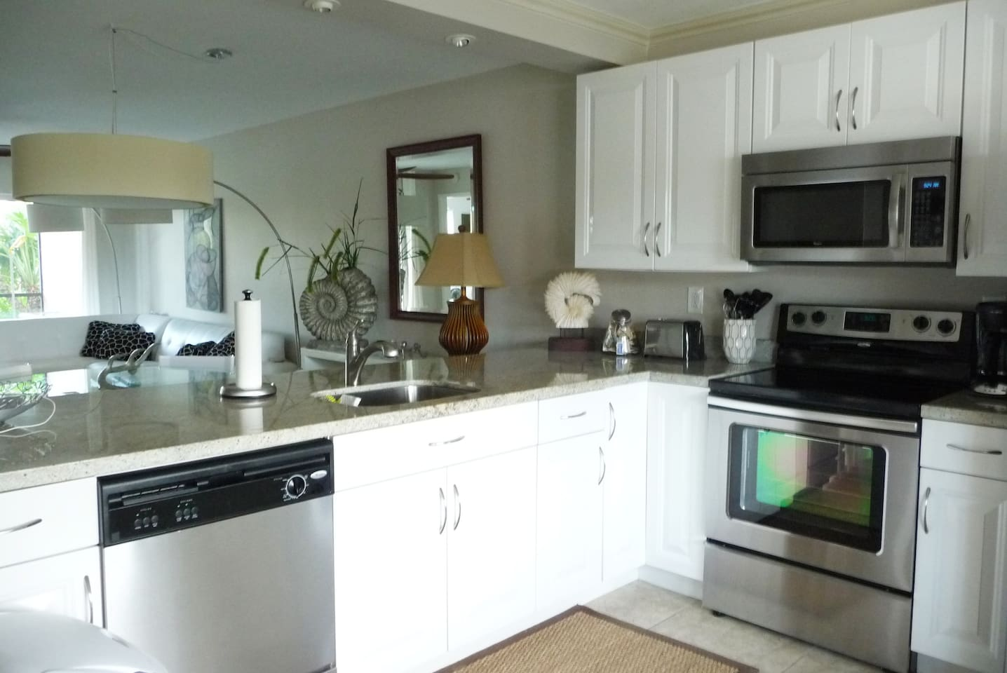 Brand new kitchen with granite counters and stainless appliances.  Breakfast bar with 4 counter stools as well as café table and chairs.