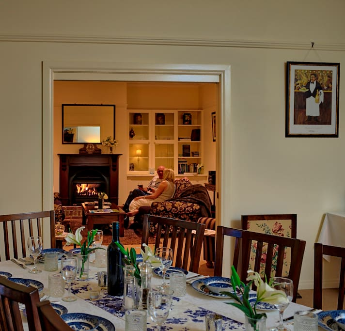 Formal dining and lounge room with gas log fireplace