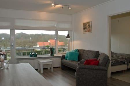 Appartement achter duinen en strand