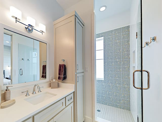 En-suite to the 2nd bedroom, the bathroom offers a large walk-in shower with glass door. All bathrooms are stocked with plenty of hotel-quality towels.