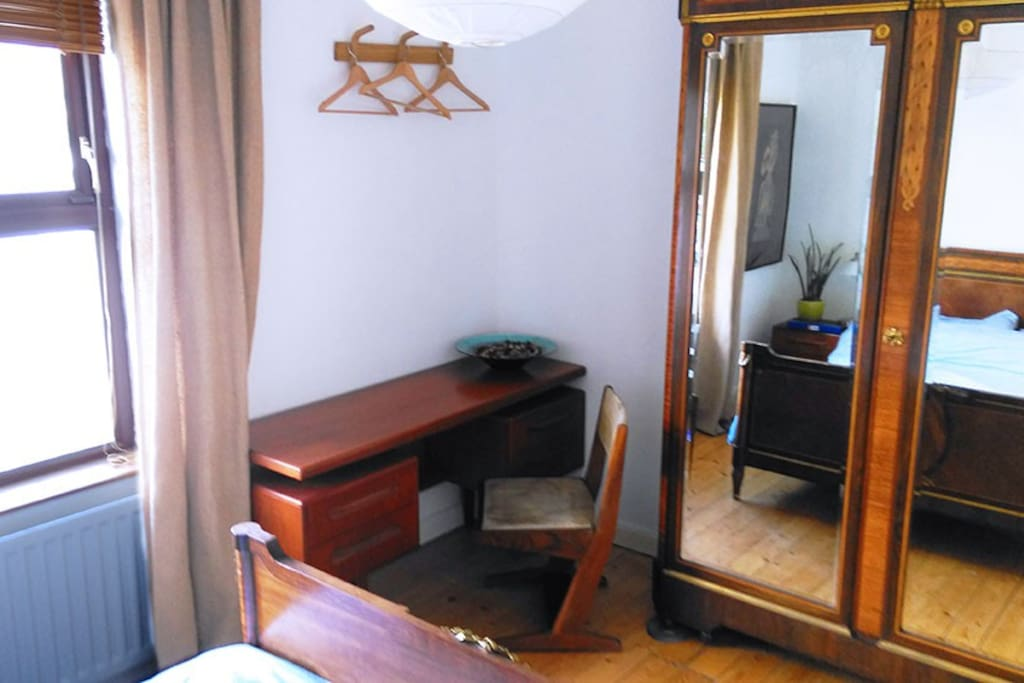 Bed: writing desk & antique linen press (shelving)