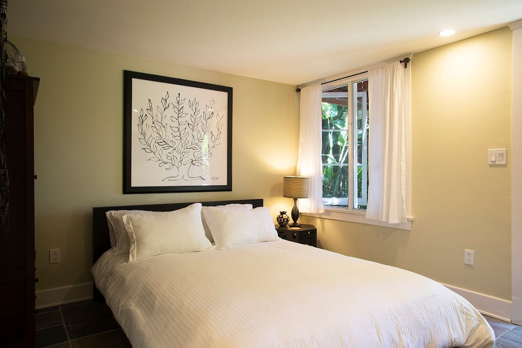 Zen bedroom looks opens to beautiful gardens and canyon.