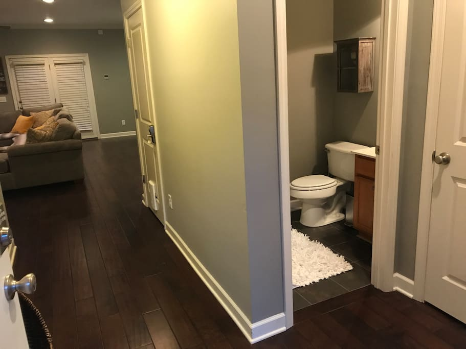 FRONT ENTRANCE Foyer leads to living room or turn right to enter the 1/2 bathroom or laundry room