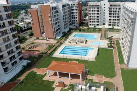 Habitacion en condominio con piscina, Wi-fi TV AC
