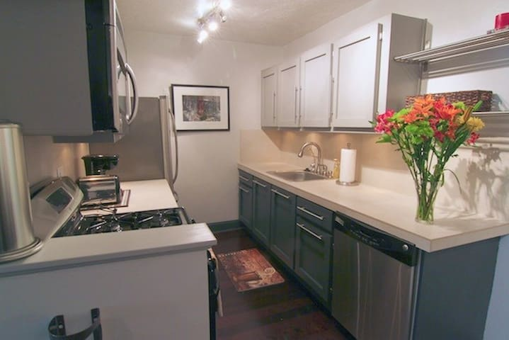 Fully equipped kitchen with gas stove, stainless appliances, and dishwasher