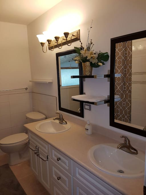 Double sink, newly renovated bathroom with brand new bath tub.