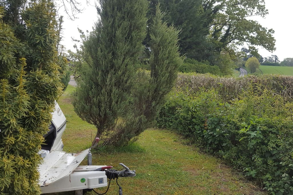 a quiet nook of the garden to wake up in self contained caravan - shower, cassette toilet, television - comfortable memory foam enhanced double bed - what are you waiting for? room for 2 singles for van share.