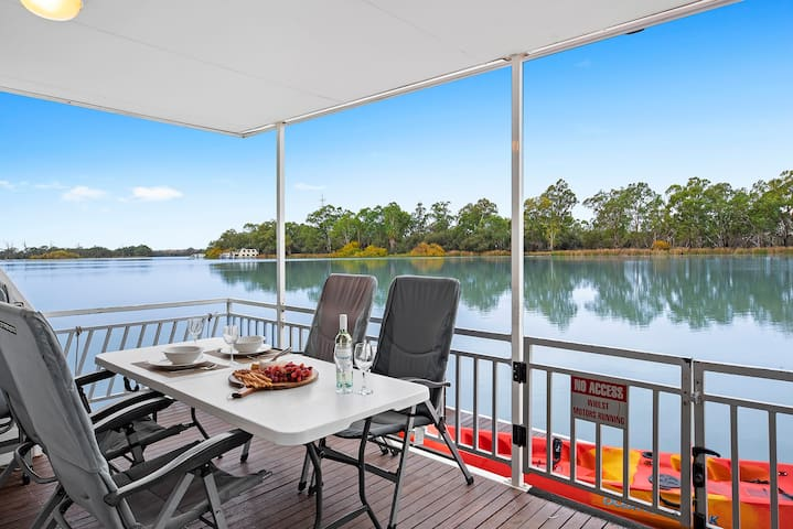Spacious undercover rear deck for dining with a view!  Kayak included in your houseboat booking