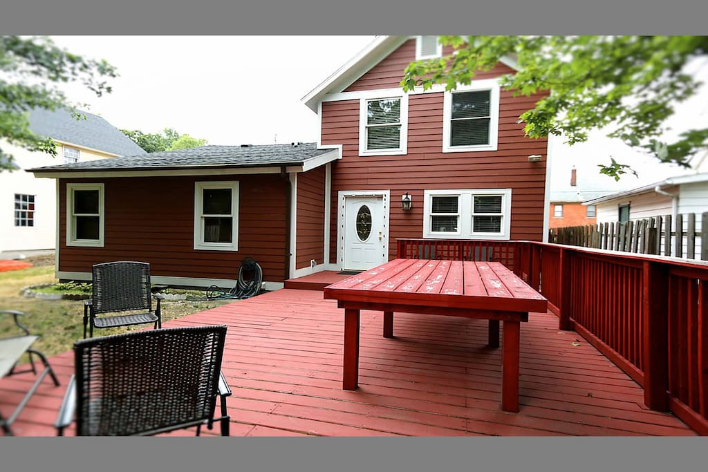 Back deck with big, moveable table & chairs.  Kitchen is just inside back door