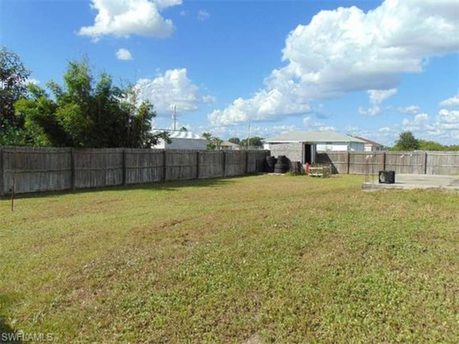 Spacious backyard with open patio, great for entertainment!