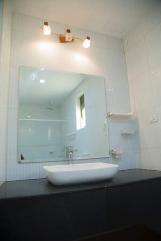 Sink and mirror in the bathroom with warm and cold water