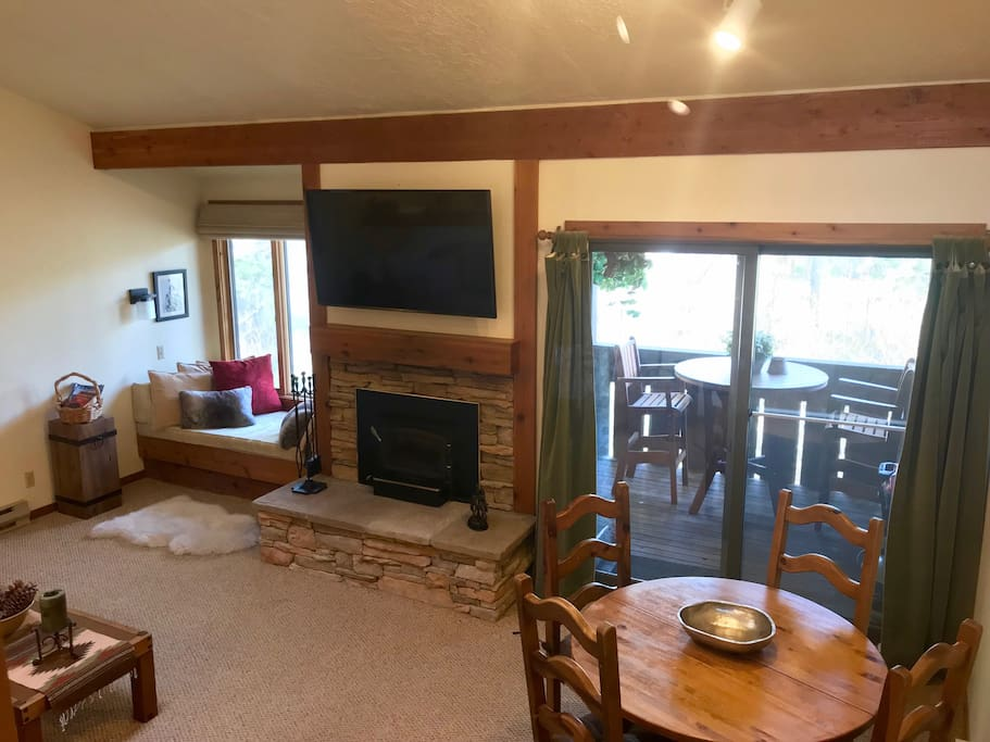 Living and dinning room with window bed and out door patio