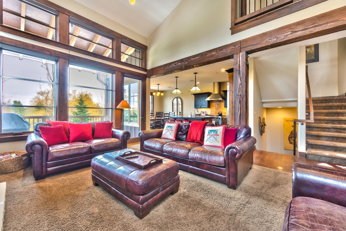 """Main level living room with gas fireplace, 55"""" TV, and cozy seating"""