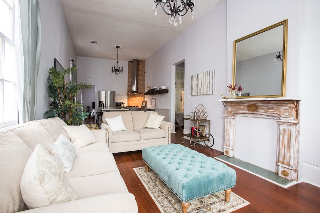 Enter through the bright living room, which offers plenty of comfortable seating and a queen size pull out sofa.