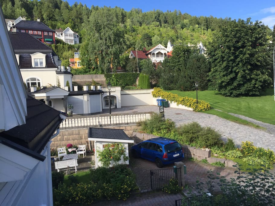 View from kitchen showing free parking space - the road across takes you to the popular Spiralen for forest walks during sommer and skiing in winter.