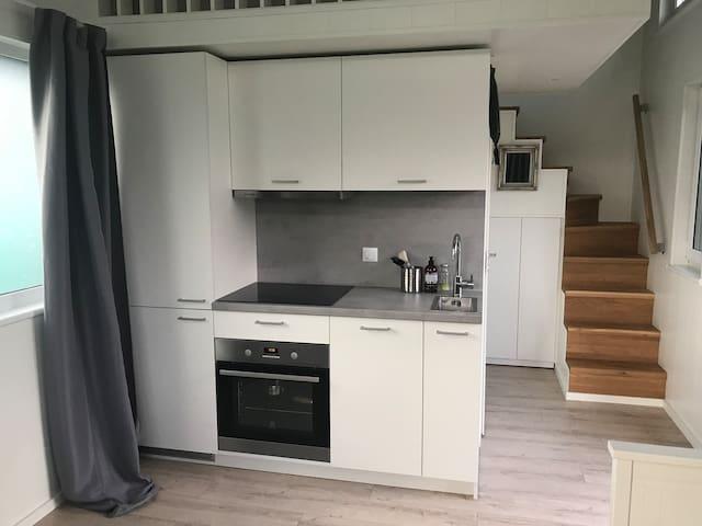 Kitchen with owen and dishwasher.