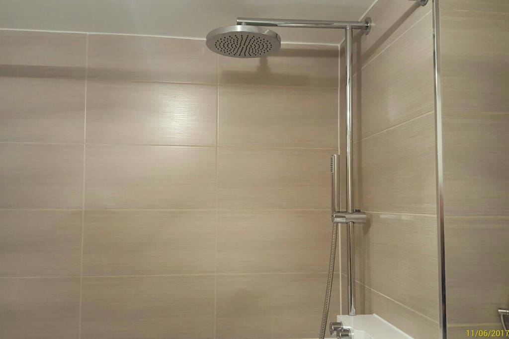 Great overhead shower with strong hand held shower and good sized bath