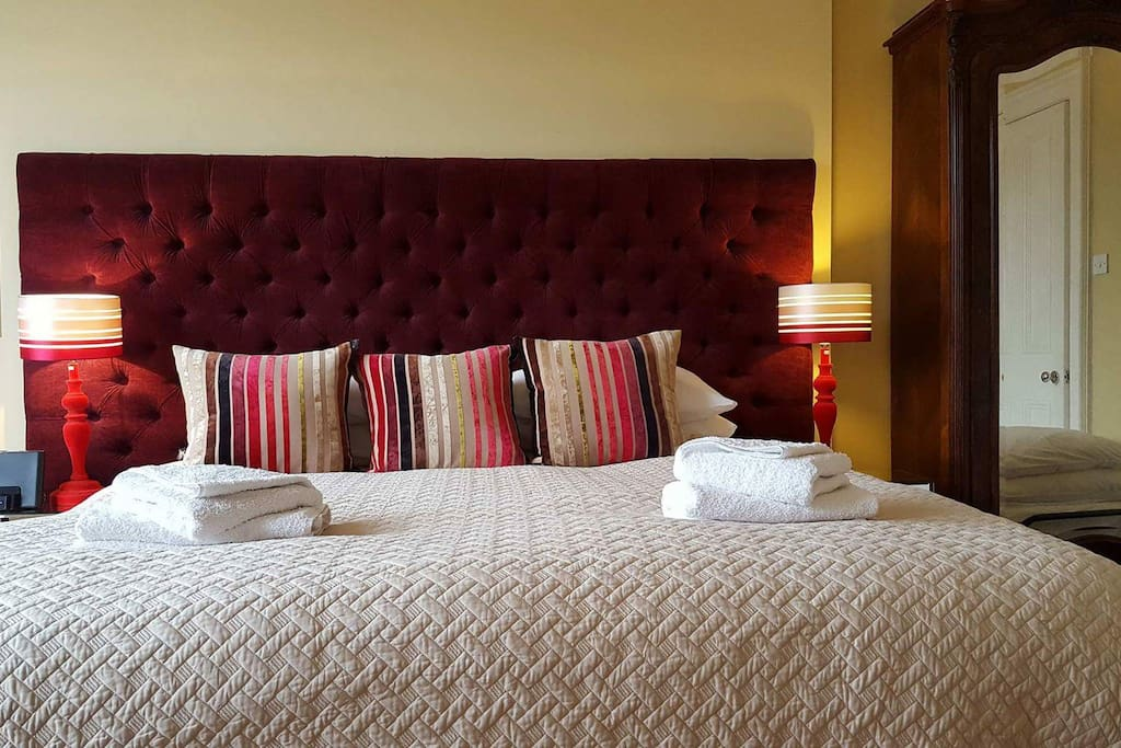 Room 2: We trust that you will enjoy a good night's sleep in the king size bed.