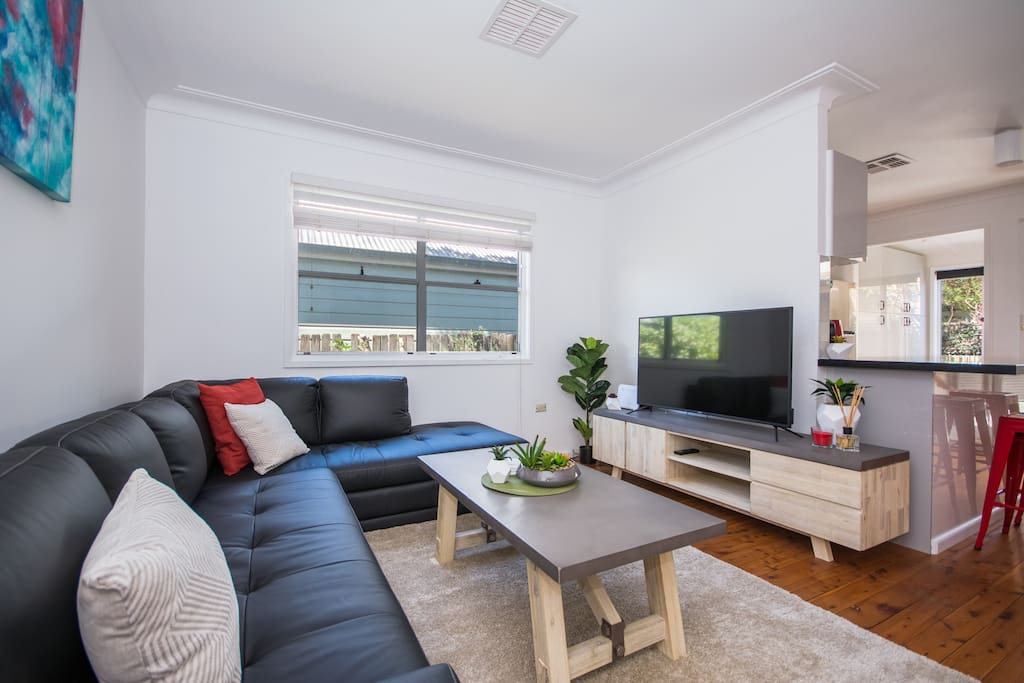 "Living room with 49"" TV, leather couch, super fast NBN internet (free) & free Netflix!"