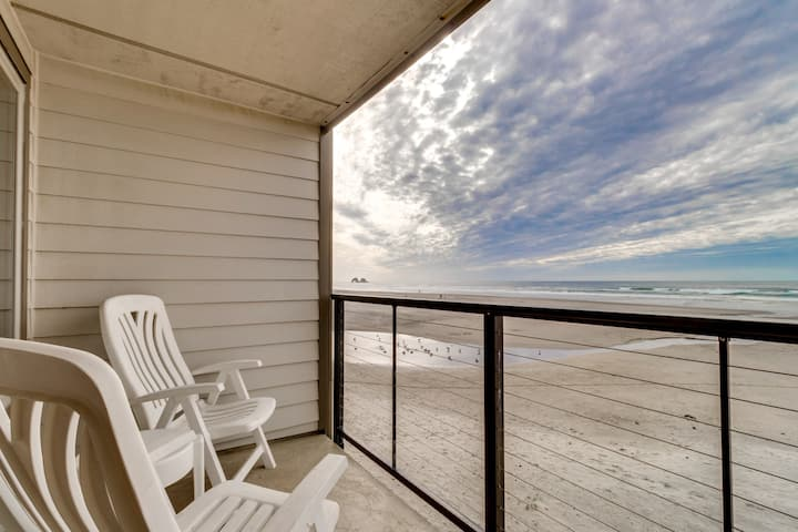 Oceanfront condo w/ a full kitchen, balcony, & sweeping sea views