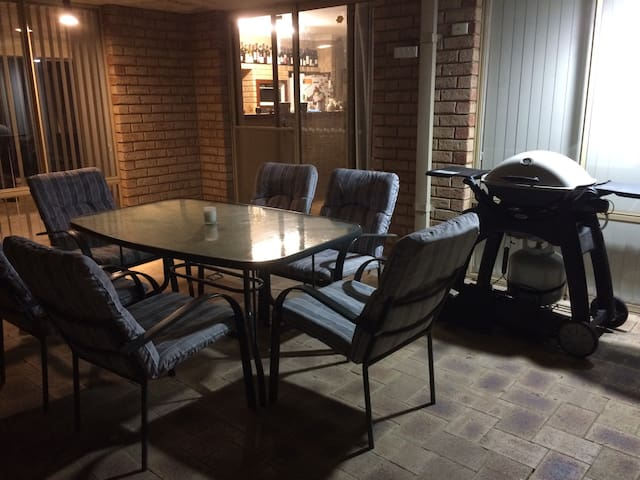 Outdoor dining space and bbq for  guest use.