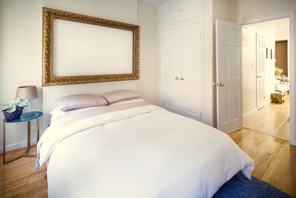 Brand new queen sized bed, soft sheets, and a feather duvet for your happy slumber. Large closet with hangers/iron/ironing board provided. Very warm radiators with adjustable heat