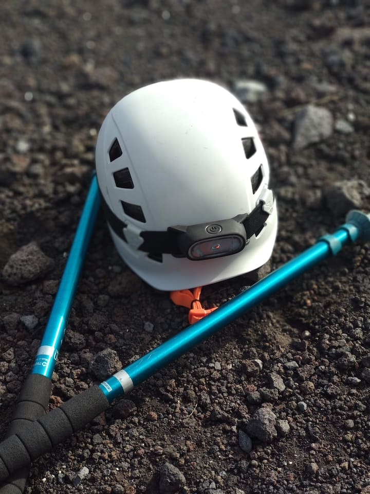 helmet and trekking poles