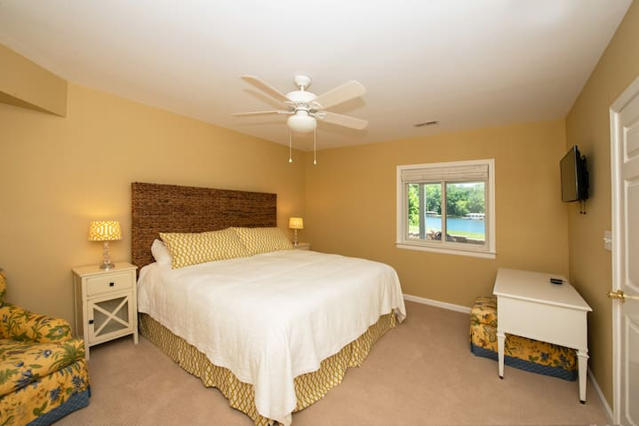 Lower level: MASTER Bedroom with KING Bed, TV, En-suite access to FULL Bath with Shower.