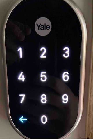 """Coded lock on SIDE door, code assigned after confirmation. Touch """"Yale"""" to wake pad and enter your code"""