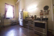 Full kitchen, featuring stove, oven, kitchen aid, confection oven, and dishwasher.