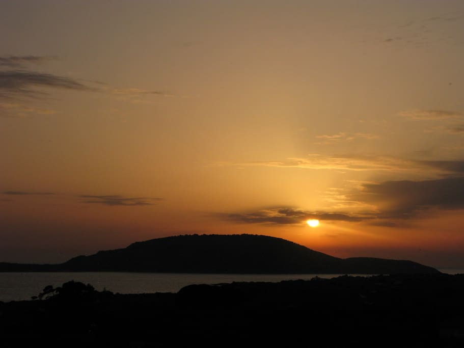 """Sunset and island """"Proti"""" from the balcony"""