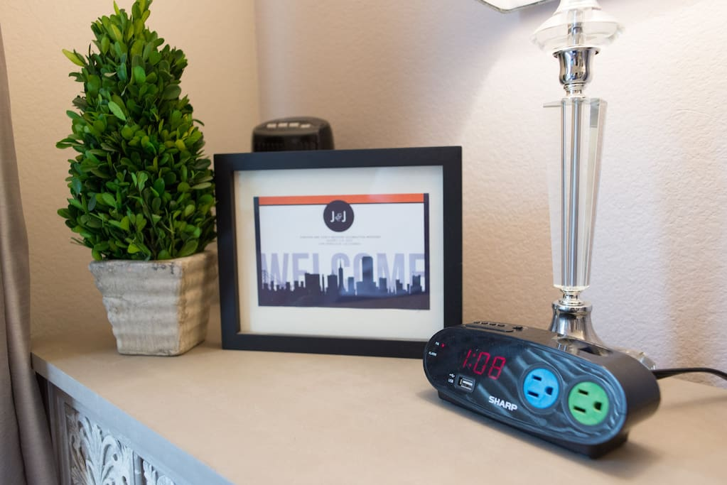 Nightstand in Guest Room with clock and plugs and usb port