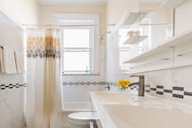 Spacious fully stocked bathroom with double sinks