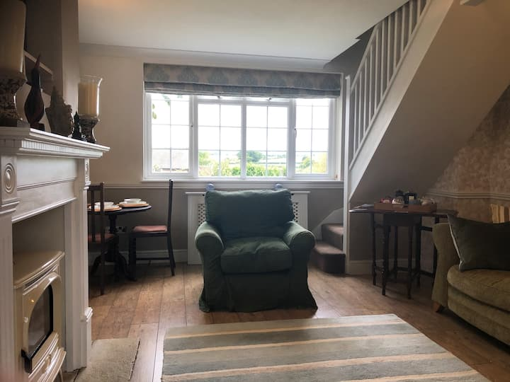 Private living, own stairs to bedroom & ensuite