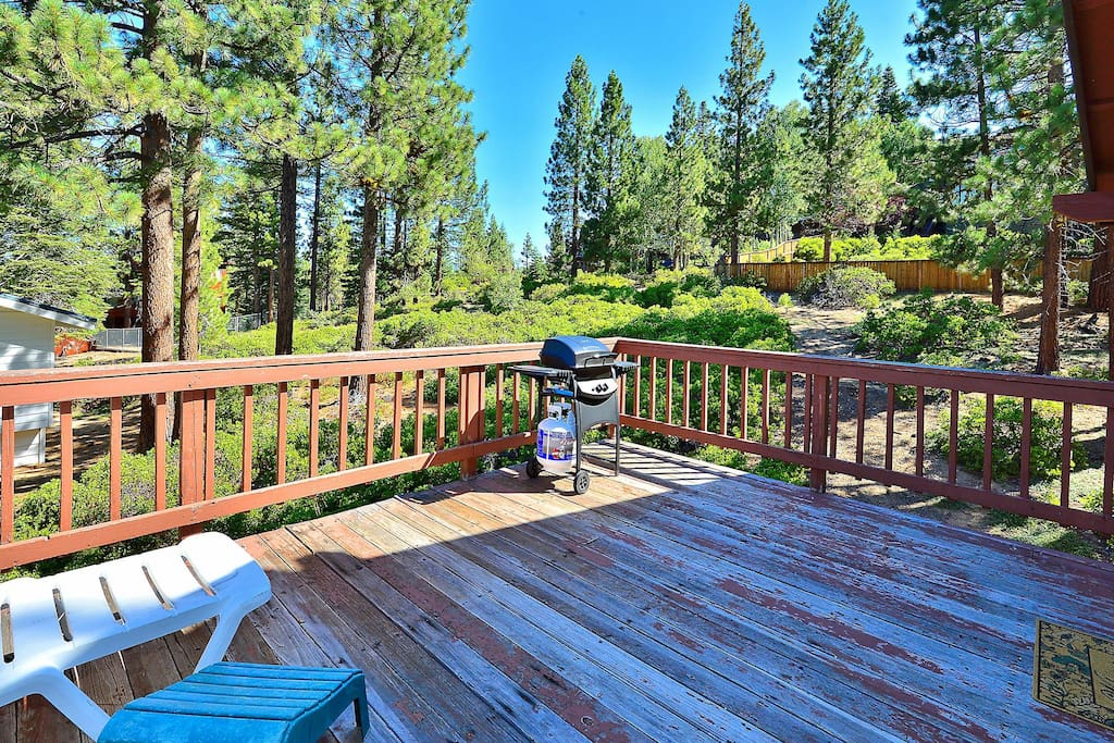 Whispering pines, rugged terrain, and a huge deck for enjoying them.