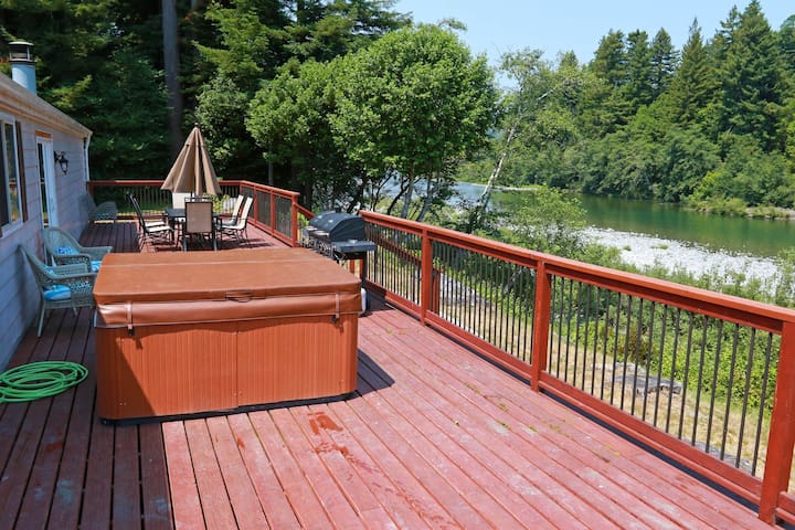 Dog-friendly, riverfront getaway w/ a private hot tub, outdoor firepit