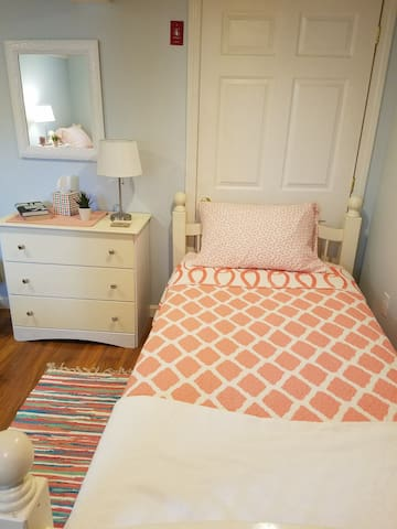 Cozy cotton quilt on twin bed