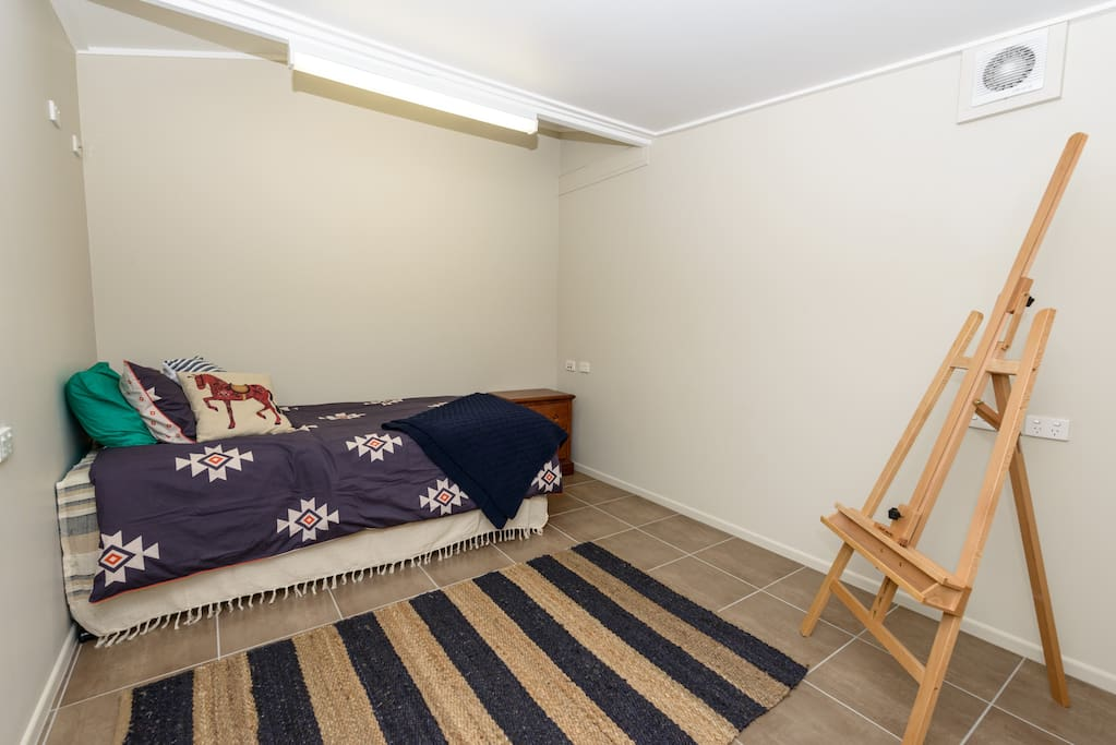 2nd bedroom.  King single with single trundle.