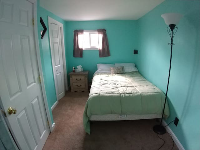 Second upstairs bedroom. Full size bed with skylight and closet.
