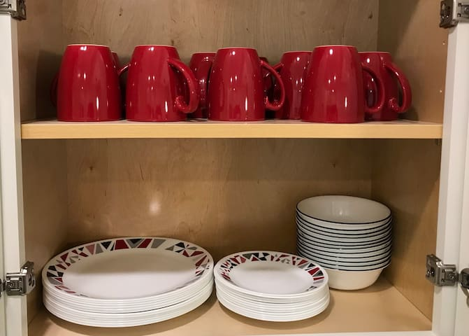 Dishes and mugs are ready for you! And the coffee pot is right below!