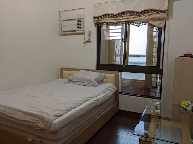 Double bedroom with air-conditioning. Also a huge wardrobe so plenty of storage space.