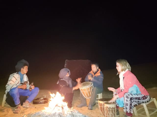 My son with his friends and aour guests enjoying time in the desert camp