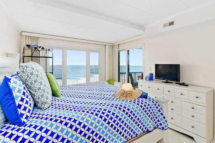 Beautiful and spacious master bedroom with great ocean views.  See and hear the ocean.  Thick and comfy memory foam style king size bed.
