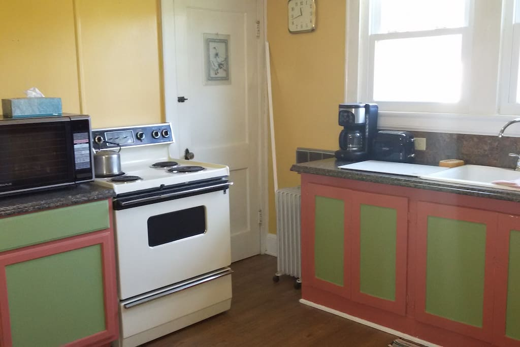 Country kitchen with basic amenities for meal prep