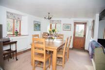 Oak dining table with door to patio garden