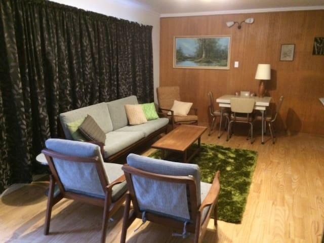 Lots of character with mid-century furniture and original features