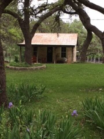 The Lodge sits away from the other cottages among the oak trees.