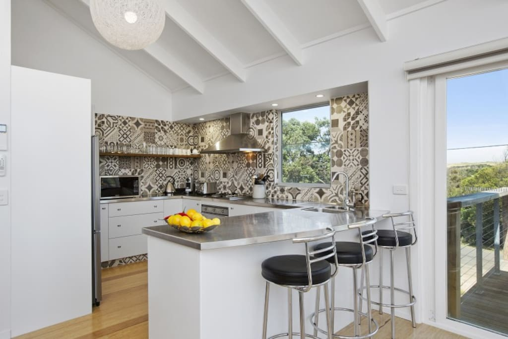 kitchen with dishwasher, smeg gas cooktop & electric oven