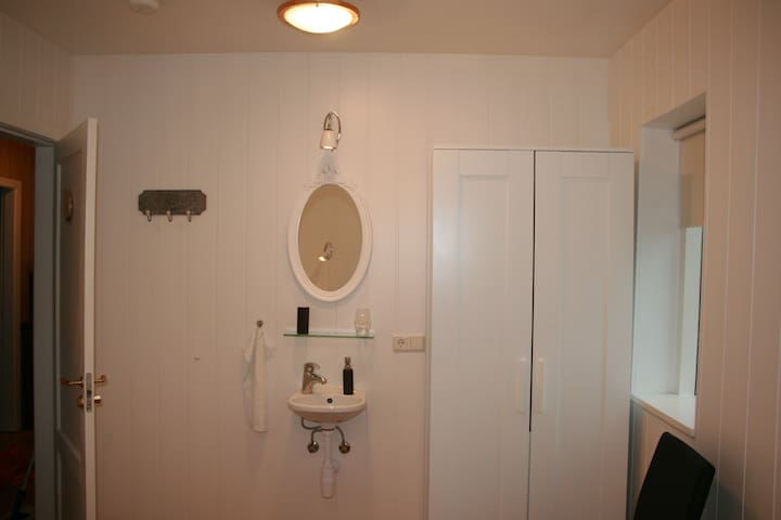 Spacious wardrobe, mirror and washbasin in each bedroom.
