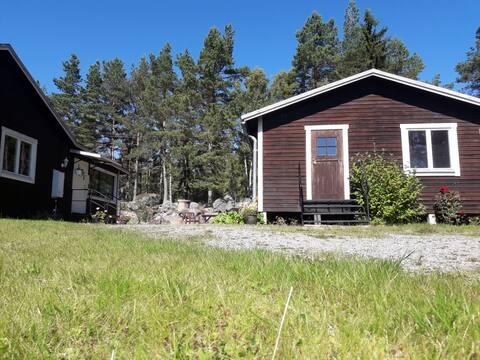 Gäststuga med sjöutsikt/Guest house with sea view